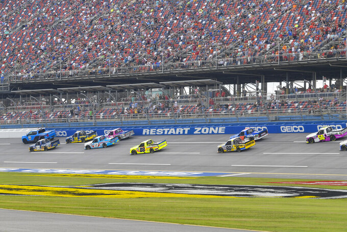 The field waits out a red flag during NASCAR Truck Series auto race Saturday, Oct. 2, 2021, in Talladega, Ala. (AP Photo/John Amis)