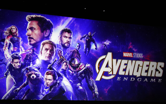 """Artwork for the Marvel film """"Avengers: Endgame"""" appears on stage during the Walt Disney Studios Motion Pictures presentation at CinemaCon, the official convention of the National Association of Theatre Owners (NATO) on April 3, 2019, in Las Vegas. Disneyland said Thursday, April 8, 2021, that its new Avengers Campus will debut on June 4, nearly a year after originally planned. (Photo by Chris Pizzello/Invision/AP, File)"""