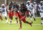 Austin Peay running back CJ Evans Jr. (23) breaks a long touchdown run against Central Arkansas during an NCAA college football game Saturday, Aug. 29, 2020, in Montgomery, Ala. (Jake Crandall/The Montgomery Advertiser via AP)
