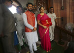 Indian Finance Minister Nirmala Sitharaman, center right, and junior Finance Minister Anurag Thakur, center, stands for the media at the parliament house before unveiling the annual federal budget in New Delhi, India, Friday, July 5, 2019. India's government says the economy is expected to grow at 7% in 2019-20, up from a five-year low of 6.8% in the past year. (AP Photo/Manish Swarup)