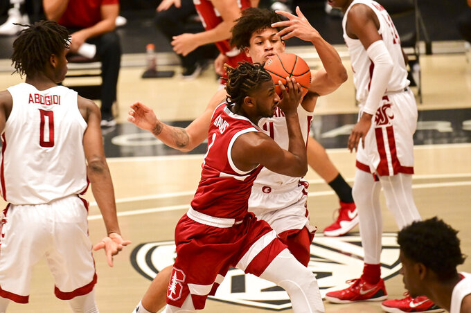 Stanford guard Daejon Davis (1) drives to the basket as Washington State forward DJ Rodman (11) defends during the first half of an NCAA college basketball game, Saturday, Feb. 20, 2021, in Pullman, Wash. (AP Photo/Pete Caster)