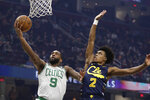 Boston Celtics' Brad Wanamaker (9) drives to the basket against Cleveland Cavaliers' Collin Sexton (2) in the first half of an NBA basketball game, Wednesday, March 4, 2020, in Cleveland. (AP Photo/Tony Dejak)