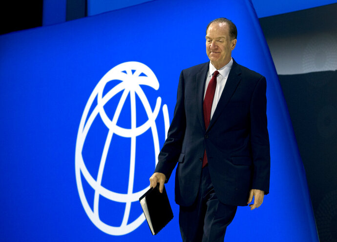 World Bank President David Malpass walks to the podium before he speaks at the opening ceremony of the World Bank/IMF Annual Meetings in Washington, Friday, Oct. 18, 2019. (AP Photo/Jose Luis Magana)
