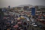 Cars wait in traffic as Afghans shop in a local market in Kabul, Afghanistan, Saturday, Sept. 11, 2021. (AP Photo/Felipe Dana)