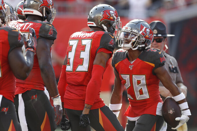 Tampa Bay Buccaneers cornerback Vernon Hargreaves III (28) celebrates his touchdown with Tampa Bay Buccaneers cornerback Carlton Davis (33) after Hargreaves made an interception during the first half an NFL football game, Sunday, Sept. 8, 2019, in Tampa, Fla. (AP Photo/Chris O'Meara)