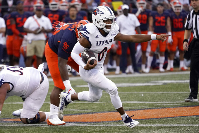 UTSA quarterback Frank Harris points out an Illinois player to be blocked during the first half of an NCAA college football game against Saturday, Sept. 4, 2021, in Champaign, Ill. (AP Photo/Charles Rex Arbogast)