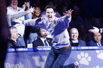 Kentucky graduate Nick Hostetter reacts after hitting a midcourt basket to win $10,000 during a break in the first half of an NCAA college basketball game between Kentucky and Auburn in Lexington, Ky., Saturday, Feb. 29, 2020. (AP Photo/James Crisp)