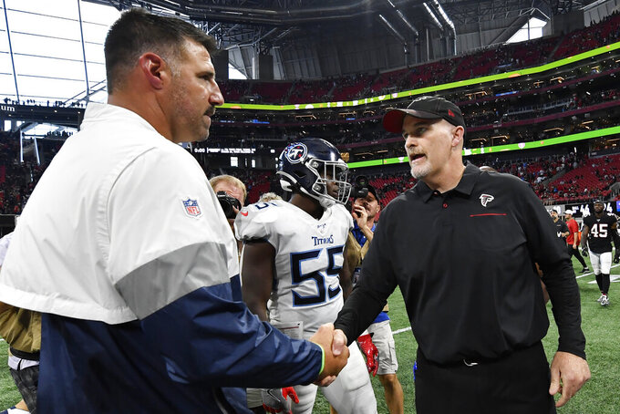 Atlanta Falcons head coach Dan Quinn, right, speaks with Tennessee Titans head coach Mike Vrabel after an NFL football game, Sunday, Sept. 29, 2019, in Atlanta. The Tennessee Titans won 24-10. (AP Photo/John Amis)