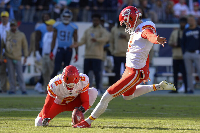 Kansas City Chiefs kicker Harrison Butker kicks a 43-yard field goal against the Tennessee Titans as Dustin Colquitt (2) holds in the second half of an NFL football game Sunday, Nov. 10, 2019, in Nashville, Tenn. (AP Photo/Mark Zaleski)
