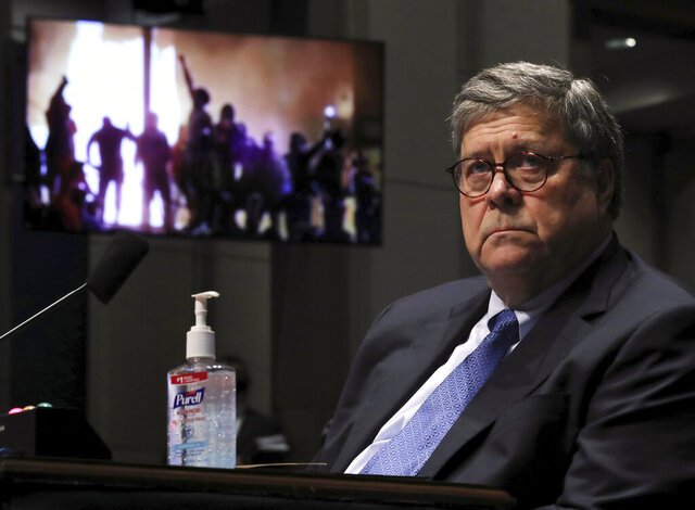 Attorney General William Barr listens during a House Judiciary Committee hearing on the oversight of the Department of Justice as a video plays in the background on Capitol Hill, Tuesday, July 28, 2020 in Washington. (Chip Somodevilla/Pool via AP)