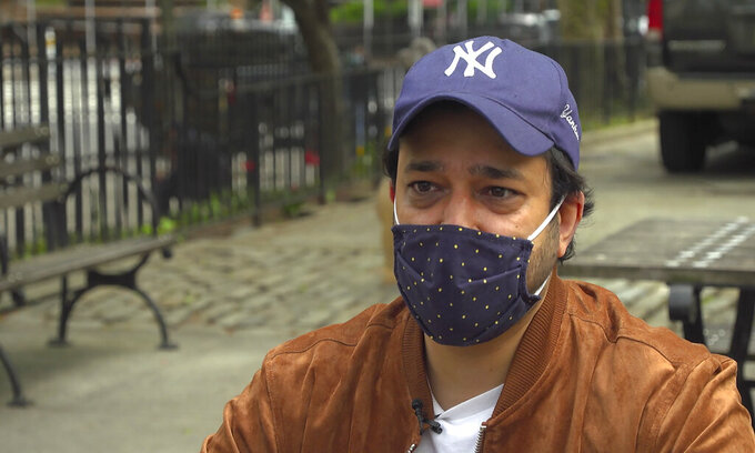 Ankur Chandra, 38, talks about his father's experience with COVID-19, during an interview Tuesday, April 27, 2021, in New York. The New York-based consultant's father is now recovering from COVID-19, alone in an apartment in India's national capital region of Gurugram. (AP Photo/David Martin)
