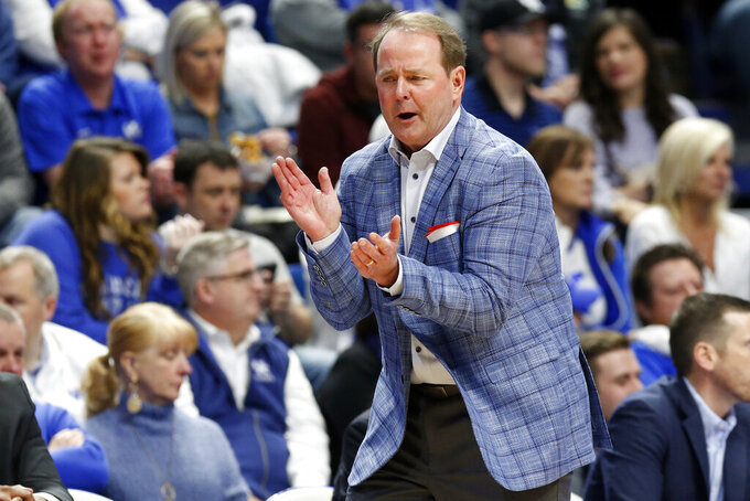 Mississippi head coach Kermit Davis urges his team on in the first half of an NCAA college basketball game against Kentucky in Lexington, Ky., Saturday, Feb. 15, 2020. (AP Photo/James Crisp)