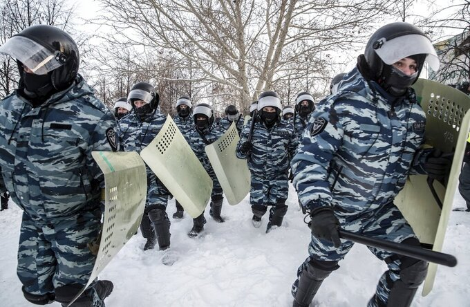 Riot police officers run during a protest against the jailing of opposition leader Alexei Navalny in Yekaterinburg, Russia, Saturday, Jan. 23, 2021. Russian police on Saturday arrested hundreds of protesters who took to the streets in temperatures as low as minus-50 C (minus-58 F) to demand the release of Alexei Navalny, the country's top opposition figure. A Navalny, President Vladimir Putin's most prominent foe, was arrested on Jan. 17 when he returned to Moscow from Germany, where he had spent five months recovering from a severe nerve-agent poisoning that he blames on the Kremlin. (AP Photo/Anton Basanayev)
