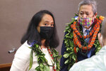 Rep. Della Au Belatti, left, the House majority leader, and House Speaker Scott Saiki speak to reporters at the Hawaii State Capitol in Honolulu on Wednesday, Jan. 20, 2021. Lawmakers opened a new legislative session in the middle of a pandemic while wearing face masks and sitting next to clear plastic shields separating their seats. (AP Photo/Audrey McAvoy)