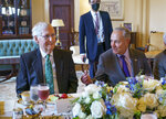 Senate Minority Leader Mitch McConnell, R-Ky., left, and Senate Majority Leader Chuck Schumer, D-N.Y., right, are seated together during a luncheon with Iraqi Prime Minister Mustafa Al-Kadhimi, at the Capitol in Washington, Wednesday, July 28, 2021. Senate Republicans have reached a deal with Democrats over major outstanding issues in a $1 trillion infrastructure bill and say they are ready to vote to take up the bill. (AP Photo/J. Scott Applewhite)