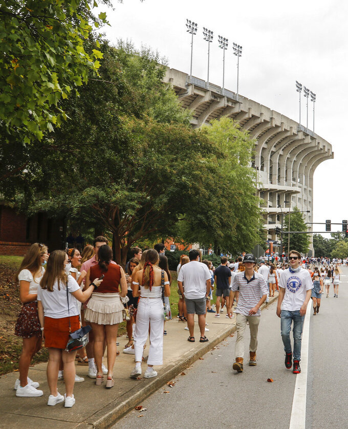 Thousands of students line up to enter the stadium before the start of an NCAA college football game between Auburn and Kentucky on Saturday, September 26, 2020 in Auburn, Alabama. (AP Photo/Butch Dill)