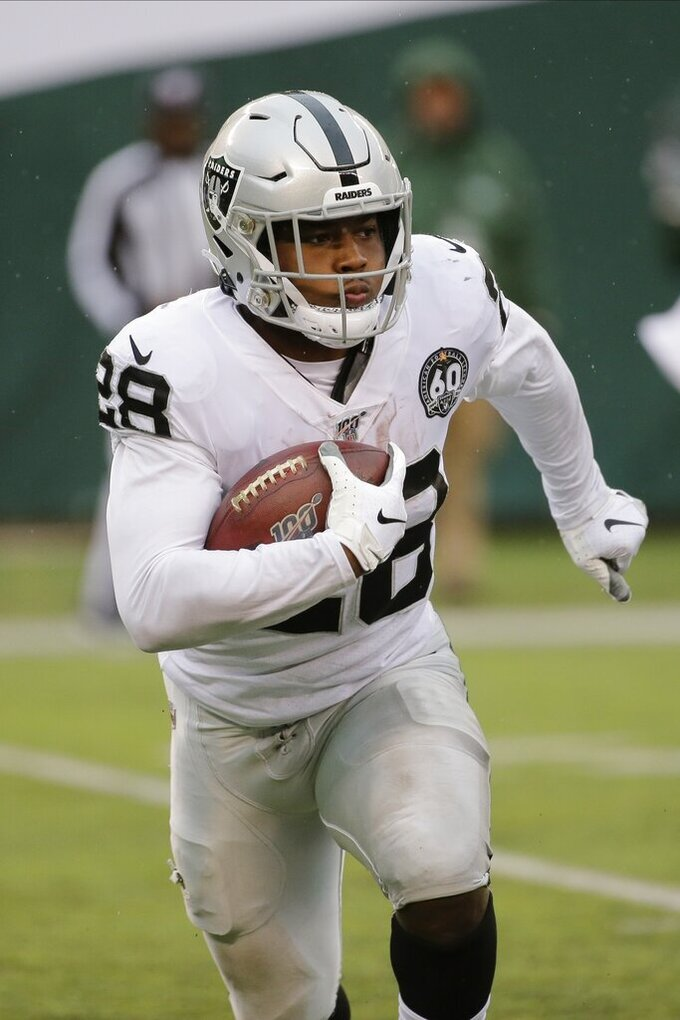 Oakland Raiders running back Josh Jacobs (28) rushes during the first half of an NFL football game against the New York Jets, Sunday, Nov. 24, 2019, in East Rutherford, N.J. (AP Photo/Seth Wenig)