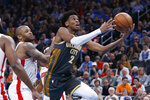 Oklahoma City Thunder guard Shai Gilgeous-Alexander (2) goes to the basket in front of Houston Rockets forward P.J. Tucker (17) during the first half of an NBA basketball game Thursday, Jan. 9, 2020, in Oklahoma City. (AP Photo/Sue Ogrocki)