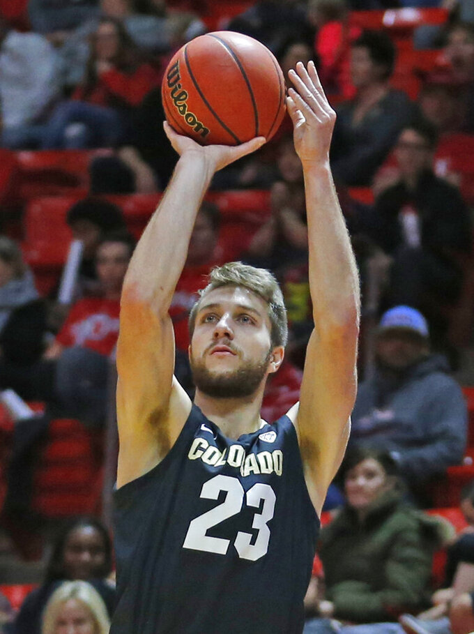 Colorado forward Lucas Siewert (23) shoots against Utah during the first half of an NCAA college basketball game Sunday, Jan. 20, 2019, in Salt lake City. (AP Photo/Rick Bowmer)