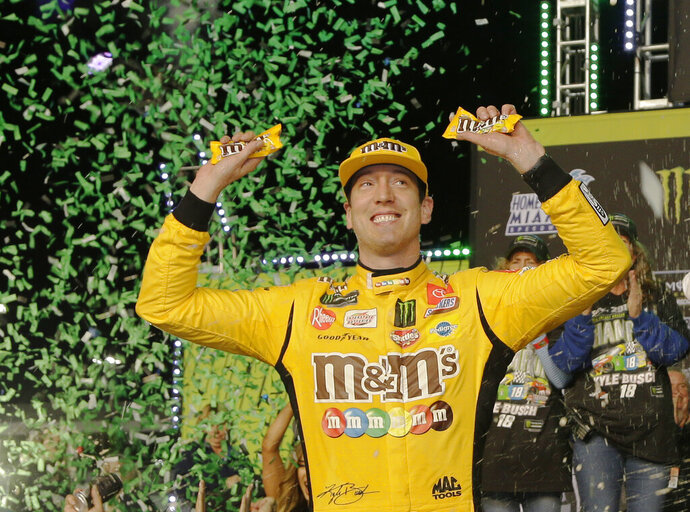 Kyle Busch celebrates in Victory Lane after winning a NASCAR Cup Series auto racing season championship on Sunday, Nov. 17, 2019, at Homestead-Miami Speedway in Homestead, Fla. (AP Photo/Terry Renna)