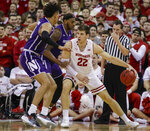 Wisconsin's Ethan Happ (22) drives against Northwestern's A.J. Turner, left, and Dererk Pardon, center, during the first half of an NCAA college basketball game Saturday, Jan. 26, 2019, in Madison, Wis. (AP Photo/Andy Manis)