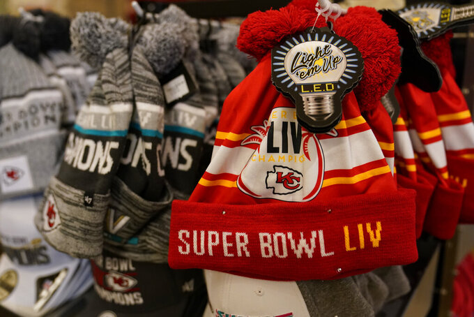 Kansas City Chiefs championship hats are displayed in a souvenir shop at Arrowhead Stadium before an NFL football game between the Chiefs and the Houston Texans Thursday, Sept. 10, 2020, in Kansas City, Mo. (AP Photo/Jeff Roberson)