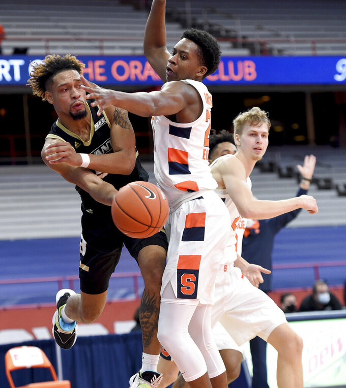 Bryant forward Hall Elisias (34) passes the ball around Syracuse forward Robert Braswell (20) during the first half of an NCAA college basketball game, Friday, Nov. 27, 2020, in Syracuse, N.Y. (Dennis Nett/The Post-Standard via AP)