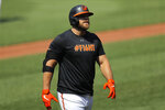 FILE - In this Friday, July 3, 2020, file photo, Baltimore Orioles' Chris Davis walks away after after batting during baseball training camp in Baltimore. (AP Photo/Julio Cortez, File)