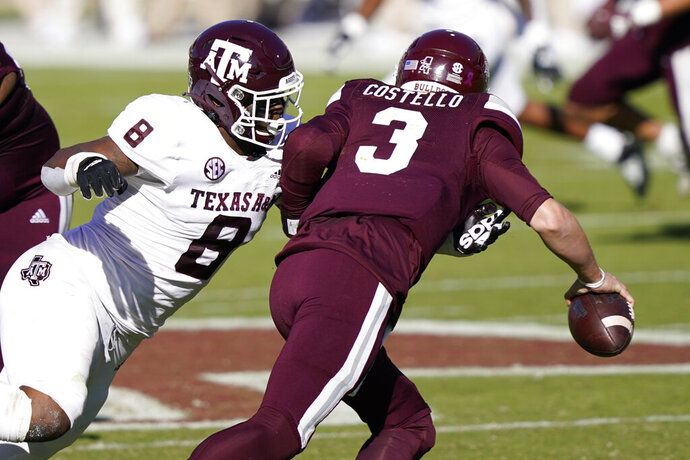 Texas A&M defensive lineman DeMarvin Leal (8) sacks Mississippi State quarterback K.J. Costello (3) during the first half of an NCAA college football game in Starkville, Miss., Saturday, Oct. 17, 2020. (AP Photo/Rogelio V. Solis)