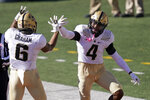 Purdue safety Jalen Graham (6) and Marvin Grant celebrate Graham's defensive touchdown off the fumble by Illinois quarterback Coran Taylor, caused by Grant, during the second half of an NCAA college football game Saturday, Oct. 31, 2020, in Champaign, Ill. (AP Photo/Charles Rex Arbogast)
