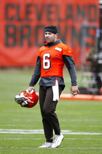 FILE - In this May 22, 2019, file photo, Cleveland Browns' Baker Mayfield walks off the field during an NFL football practice at the team's training facility in Berea, Ohio. The 24-year-old has restored hope for Browns fans, who have patiently waited for the team to find its long-term answer at the game's most critical position.  (AP Photo/Ron Schwane, FIle)