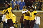 Minnesota defensive back Antoine Winfield Jr. (11) celebrates with teammates Jordan Howden (23) and Braelen Oliver (14) after breaking up a play during an NCAA college football game against South Dakota State, Thursday, Aug. 29, 2019, in Minneapolis. (AP Photo/Stacy Bengs)