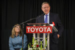West Virginia Secretary of Commerce Ed Gaunch, right, speaks after an announcement of an expansion at Toyota Motor Manufacturing, Thursday, March 14, 2019, in Buffalo, W.Va. Toyota Motor Corp. on Thursday announced it is investing an additional $750 million at five U.S. plants. (Sholten Singer/The Herald-Dispatch via AP)