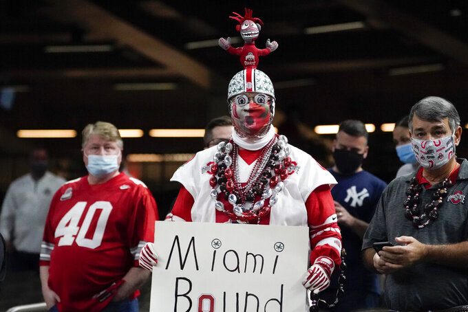 A Ohio State fan cheers during the first half of the Sugar Bowl NCAA college football game against Clemson Friday, Jan. 1, 2021, in New Orleans. (AP Photo/John Bazemore)