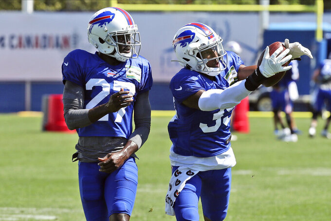FILE - In this Aug. 31, 2020, file photo, Buffalo Bills cornerback Levi Wallace (39) catches a pass in front of cornerback Tre'Davious White (27) during NFL football practice in Orchard Park, N.Y. (James P. McCoy/Buffalo News via AP, Pool, File)