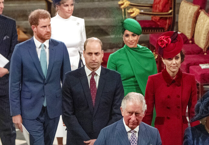 "FILE - In this Monday March 9, 2020, file photo, from left, Britain's Prince Harry, Prince William, Meghan Duchess of Sussex and Kate, Duchess of Cambridge leave the annual Commonwealth Service at Westminster Abbey in London. Prince William infuriated Prince Harry when he told his younger brother he should move slowly in his relationship with the former Meghan Markle, fearing that he was  being ""blindsided by lust,'' a new book on the Windsors says. The second installment of a serialized version of the book ""Finding Freedom,"" which appeared in the Sunday Times, Sunday, July 26, 2020 claimed that Harry was angered by what he perceived to be as William's snobby tone in a discussion about the American actress.(Phil Harris/Pool via AP, file)"