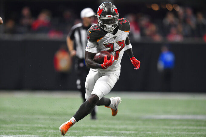 Tampa Bay Buccaneers running back Ronald Jones (27) runs against the Atlanta Falcons during the second half of an NFL football game, Sunday, Nov. 24, 2019, in Atlanta. (AP Photo/John Amis)