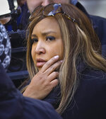 In this March 6, 2019 photo, HUD executive Lynne Patton, listens as a resident at the New York City Housing Authority's Queensbridge Houses in New York complains about conditions in her apartment. Patton says she wanted to shine a spotlight on public housing ills such as mold and heat and hot water outages by spending a week at a time in four different complexes run by the New York City Housing Authority. (AP Photo/Bebeto Matthews)