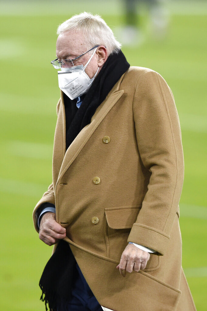 Dallas Cowboys owner Jerry Jones wears a face mask to protect against COVID-19 while walking on the field prior to an NFL football game against the Baltimore Ravens, Tuesday, Dec. 8, 2020, in Baltimore. (AP Photo/Gail Burton)