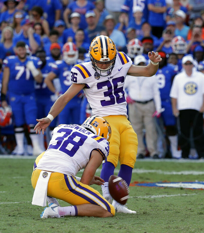 FILE - In this Oct. 6, 2018, file photo, LSU place kicker Cole Tracy (36) kicks a field goal against Florida during the first half of an NCAA college football game, in Gainesville, Fla. LSU (6-1, 3-1 SEC) takes on Mississippi State (4-2, 1-2) on Saturday, Oct. 20. If the game is a close, defensive struggle, LSU likes its chances with kicker Cole Tracy, a transfer from Division II Assumption College. He is 17-for-19 on field goals this season and 5-for-5 last week. (AP Photo/John Raoux, File)