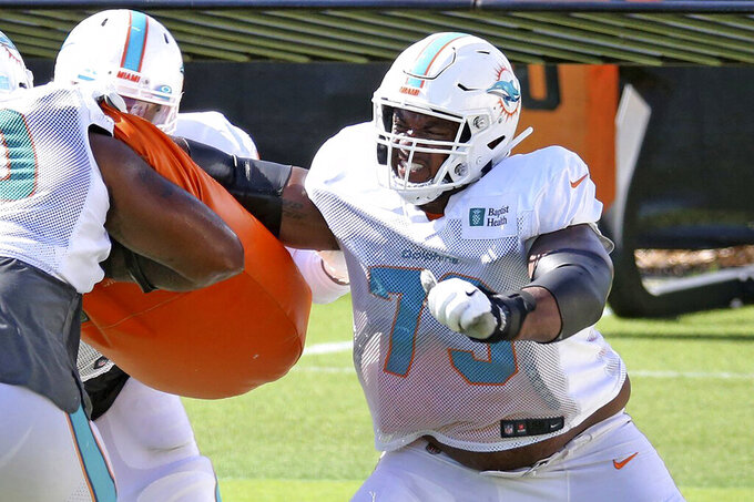 FILE - Miami Dolphins rookie tackle Austin Jackson (73) runs a drill during NFL football training camp Monday, Aug. 31, 2020, in Miami. At least four Miami Dolphins rookies are expected to see significant action in Sunday's, Sept. 13 opener. (Charles Trainor Jr./Miami Herald via AP, File)