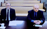 FILE - In this image made from video, from left, father and son, Gregory and Travis McMichael, accused in the shooting death of Ahmaud Arbery in Georgia on Feb. 2020, listen via closed circuit tv in the Glynn County Detention center in Brunswick, Ga., on Thursday, Nov. 12, as lawyers argue for bond to be set at the Glynn County courthouse. A judge is expected to delve into the jury selection process at a hearing Thursday, July 22, 2021, for the upcoming murder trial of three men, including the McMichaels, accused of killing Ahmaud Arbery, a Black man who was chased and shot after he was spotted running in a Georgia neighborhood. (AP Photo/Lewis Levine, File)