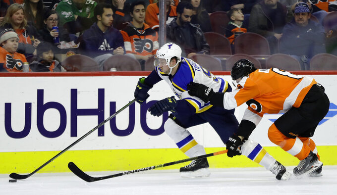 St. Louis Blues' Vladimir Tarasenko, left, tries to slips past Philadelphia Flyers' Robert Hagg during the first period of an NHL hockey game, Monday, Jan. 7, 2019, in Philadelphia. (AP Photo/Matt Slocum)