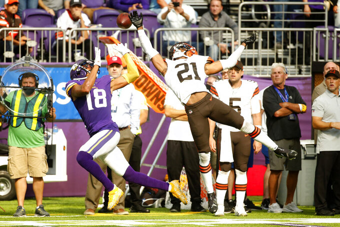 Cleveland Browns cornerback Denzel Ward (21) breaks up a pass intended for Minnesota Vikings wide receiver Justin Jefferson (18) during the second half of an NFL football game, Sunday, Oct. 3, 2021, in Minneapolis. The Browns won 14-7. (AP Photo/Bruce Kluckhohn)
