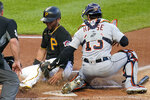 Detroit Tigers catcher Eric Haase (13) tags out Pittsburgh Pirates' Michael Perez, who was attempting to score from third during the second inning of a baseball game in Pittsburgh, Tuesday, Sept. 7, 2021. (AP Photo/Gene J. Puskar)