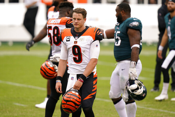 Cincinnati Bengals' Joe Burrow walks off the field after an NFL football game against the Philadelphia Eagles, Sunday, Sept. 27, 2020, in Philadelphia. (AP Photo/Chris Szagola)