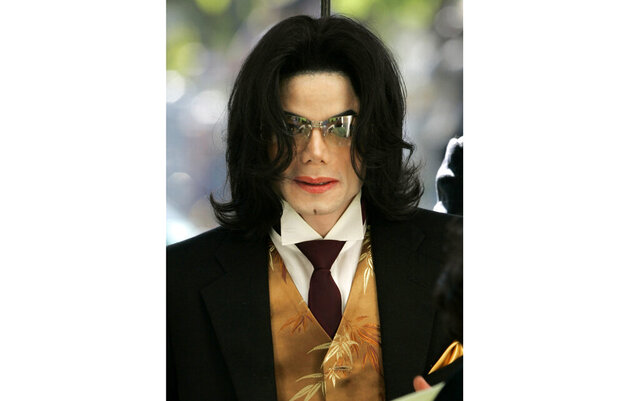FILE - Michael Jackson arrives at the Santa Barbara County courthouse on May 12, 2005, for his child molestation trial in Santa Maria, Calif. A federal appeals court has ruled that a lawsuit filed by the Michael Jackson estate over