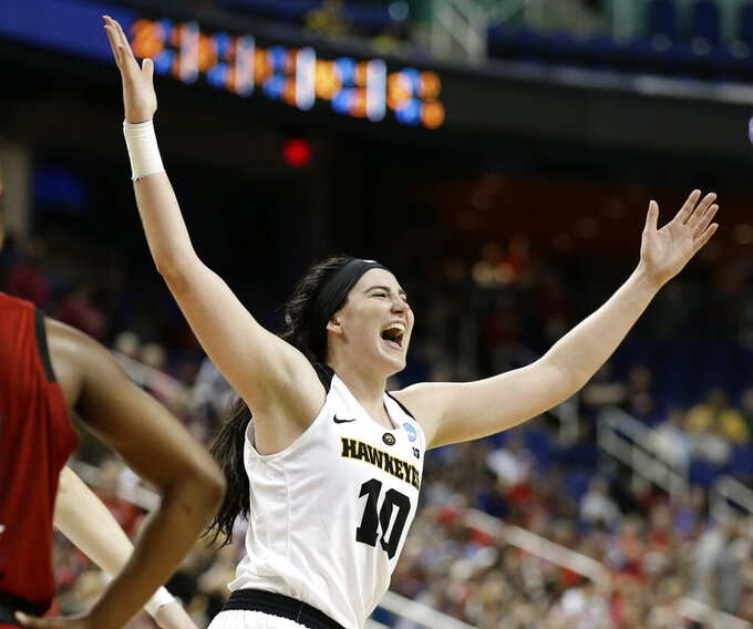 FILE - In this March 30, 2019, file photo, Iowa's Megan Gustafson reacts as she leaves the court during the second half of a regional women's college basketball game against North Carolina State, in the NCAA Tournament in Greensboro, N.C. Gustafson was named The Associated Press Player of the Year, Thursday, April 4, 2019. (AP Photo/Gerry Broome, File)