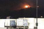 Fire is seen from an explosion at an army's munitions depot near the coastal city of Kyrenia in the Turkish occupied area at northern Cyprus, early Thursday, Sept. 12, 2019. A pre-dawn explosion at an army munitions depot in breakaway northern Cyprus shattered window panes and slightly injured 12 people while fires ignited by the blast were brought under control, Turkey's defense ministry and Turkish Cypriot officials said. (AP Photo/Nedim Enginsoy)