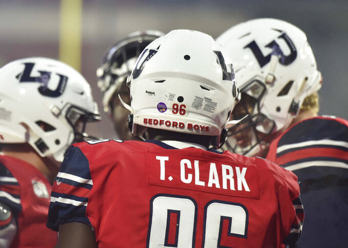 Liberty defensive end TreShaun Clark sports a Bedford Boys helmet during an NCAA college football game against New Mexico State at Williams Stadium at Liberty University in Lynchburg, Va., Saturday, Nov. 30, 2019. (Taylor Irby/The News & Advance via AP)